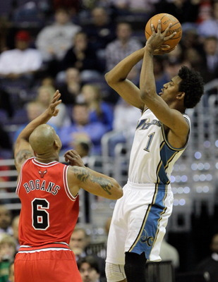 WASHINGTON, DC - FEBRUARY 28: Nick Young #1 of the Washington Wizards shoots over Keith Bogans #6 of the Chicago Bulls at the Verizon Center in Washington on February 28, 2011 in Washington, DC. NOTE TO USER: User expressly acknowledges and agrees that, b