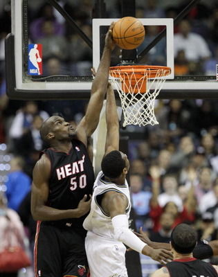 WASHINGTON, DC - MARCH 30: Joel Anthony #50 of the Miami Heat blocks a shot by John Wall #2 of the Washington Wizards during the first half at the Verizon Center on March 30, 2011 in Washington, DC. NOTE TO USER: User expressly acknowledges and agrees tha