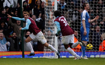 LONDON, ENGLAND - NOVEMBER 27: Valon Behrami of West Ham (L) celebrates after scoring their first goal during the Barclays Premier League match between West Ham United and Wigan Athletic at Boleyn Ground on November 27, 2010 in London, England.  (Photo by