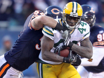 CHICAGO, IL - JANUARY 23:  James Starks #44 of the Green Bay Packers runs the ball as he is hit by Brian Urlacher #54 of the Chicago Bears in the NFC Championship Game at Soldier Field on January 23, 2011 in Chicago, Illinois.  (Photo by Andy Lyons/Getty