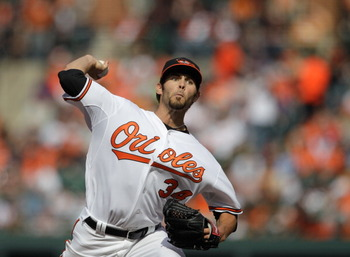 BALTIMORE, MD - APRIL 04:  Starting pitcher Jake Arrieta #34 of the Baltimore Orioles delivers to a Detroit Tigers batter during the second inning during opening day at Oriole Park at Camden Yards on April 4, 2011 in Baltimore, Maryland.  (Photo by Rob Ca