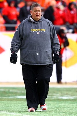 KANSAS CITY, MO - JANUARY 09:  Offensive coordinator Charlie Weis of the Kansas City Chiefs walks in the field prior to playing the Baltimore Ravens in their 2011 AFC wild card playoff game at Arrowhead Stadium on January 9, 2011 in Kansas City, Missouri.