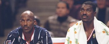 11 Nov 1997:  Guard Clyde Drexler and center Hakeem Olajuwon of the Houston Rockets sit on the bench during a game against the Chicago Bulls at the United Center in Chicago, Illinois.  The Bulls won the game 110-86. Mandatory Credit: Brian Bahr  /Allsport