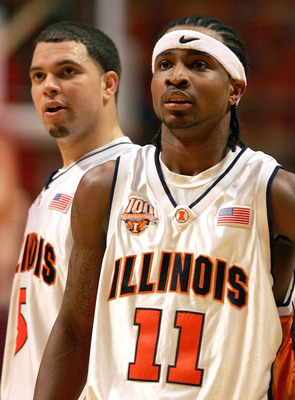 CHAMPAIGN, IL - FEBRUARY 12: Dee Brown #11 and Deron Williams #5 of the Illinois Fighting Illini wait for a member of the Wisconsin Badgers to shoot a free-throw on February 12, 2005 at the Assembly Hall at the University of Illinois in Champaign, Illinoi