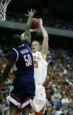 SAN ANTONIO - MARCH 28:  Jason Klotz #21 of the University of Texas Longhorns shoots over Emeka Okafor #50 of the University of Connecticut Huskies during the south regional semifinals of the NCAA Division I Men's Tournament at the Alamodome on March 28,