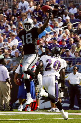 BALTIMORE - SEPTEMBER 17:  Randy Moss #18 of the Oakland Raiders leaps for a pass over Baltimore Ravens safety Ed Reed #20 in fourth quarter action on September 17, 2006 at M&T Bank Stadium in Baltimore, Maryland. The Ravens defeated the Raiders 28-6.  (P