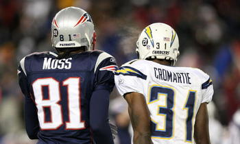 FOXBORO, MA - JANUARY 20:  (L-R) Randy Moss #81 of the New England Patriots stands on the field next to Antonio Cromartie #31 of the San Diego Chargers during the AFC Championship Game on January 20, 2008 at Gillette Stadium in Foxboro, Massachusetts. The