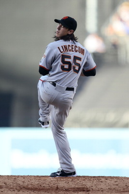 LOS ANGELES, CA - MARCH 31:  Tim Lincecum #55 of the San Francisco Giants throws a pitch against the Los Angeles Dodgers on Opening Day at Dodger Stadium on March 31, 2011 in Los Angeles, California.  (Photo by Jeff Gross/Getty Images)