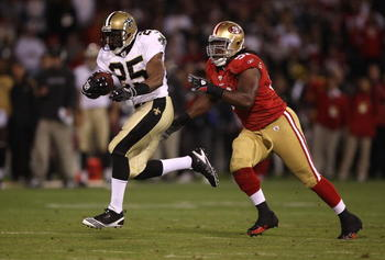SAN FRANCISCO - SEPTEMBER 20:  Reggie Bush #25 of the New Orleans Saints runs against Ray McDonald #91 of the San Francisco 49ers during an NFL game at Candlestick Park on September 20, 2010 in San Francisco, California.  (Photo by Jed Jacobsohn/Getty Ima