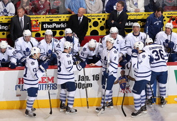 GLENDALE, AZ - JANUARY 13: (L-R) Tyler Bozak #42, Mike Brown #18, Colby Armstrong #9, Luke Schenn #2 and Carl Gunnarsson #36 of the Toronto Maple Leafs skate up to the bench during a time out from the NHL game against the Phoenix Coyotes at Jobing.com Are