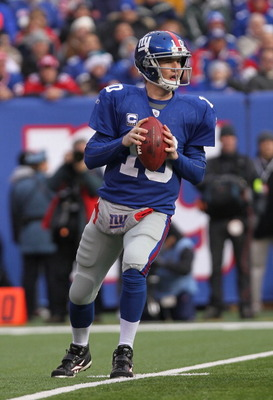 EAST RUTHERFORD, NJ - DECEMBER 19:  Eli Manning #10 of the New York Giants passes against the Philadelphia Eagles at New Meadowlands Stadium on December 19, 2010 in East Rutherford, New Jersey.  (Photo by Nick Laham/Getty Images)