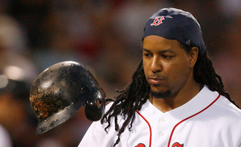 BOSTON - JULY 30: Manny Ramirez #24 of the Boston Red Sox reacts after making an out during his final at bat as a member of the Red Sox against the Los Angeles Angels of Anaheim at Fenway Park on July 30, 2008 in Boston, Massachusetts.  (Photo by Jim Roga