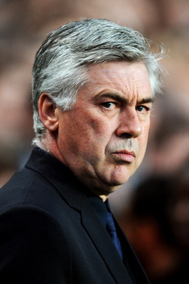 LONDON, ENGLAND - APRIL 06:  Carlo Ancelotti the Chelsea manager looks on prior to kickoff during the UEFA Champions League quarter final first leg match between Chelsea and Manchester United at Stamford Bridge on April 6, 2011 in London, England.  (Photo