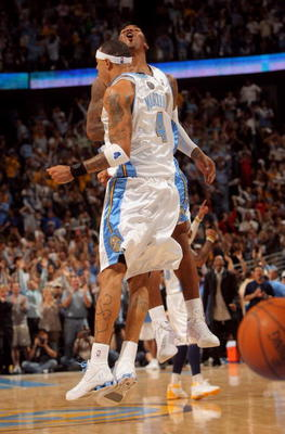 DENVER - MAY 13:  Kenyon Martin #4 and J.R. Smith #1 of the Denver Nuggets celebrate after a play against the Dallas Mavericks late in Game Five of the Western Conference Semifinals during the 2009 NBA Playoffs at Pepsi Center on May 13, 2009 in Denver, C