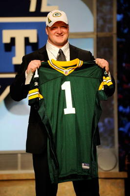 NEW YORK - APRIL 22:  Bryan Bulaga from the Iowa Hawkeyes holds up a Green Bay Packers jersey after the Packers drafted him number 23 overall during the first round of the 2010 NFL Draft at Radio City Music Hall on April 22, 2010 in New York City.  (Photo