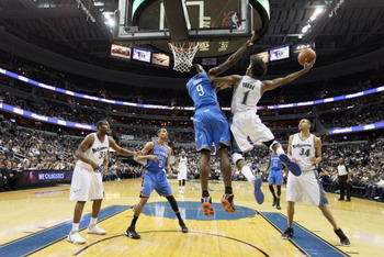 WASHINGTON, DC - MARCH 14: Serge Ibaka #9 of the Oklahoma City Thunder defends against Nick Young #1 of the Washington Wizards during the first half at the Verizon Center on March 14, 2011 in Washington, DC. NOTE TO USER: User expressly acknowledges and a