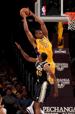 LOS ANGELES, CA - APRIL 5:  Andrew Bynum #17 of the Los Angeles Lakers jumps to catch a pass over Jeremy Evans #40 of the Utah Jazz at Staples Center on April 5, 2011 in Los Angeles, California.  NOTE TO USER: User expressly acknowledges and agrees that,