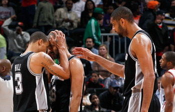 ATLANTA, GA - APRIL 05:  George Hill #3 and Tim Duncan #21 celebrate with Tony Parker #9 of the San Antonio Spurs after Parker drew a foul in the final seconds of their 97-90 win over the Atlanta Hawks at Philips Arena on April 5, 2011 in Atlanta, Georgia