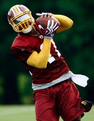 ASHBURN, VA - JULY 30:  Washington Redskins wide receiver Devin Thomas (#11) catches a pass during drills on opening day of training camp July 30, 2009 in Ashburn, Virginia.  (Photo by Win McNamee/Getty Images)