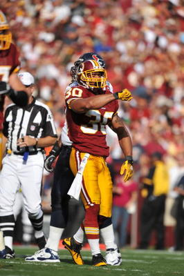 LANDOVER, MD - SEPTEMBER 19:  LaRon Landry #30 of the Washington Redskins celebrates a play against the Houston Texans at FedExField on September 19, 2010 in Landover, Maryland. The Texans defeated the Redskins in overtime 30-27. (Photo by Larry French/Ge