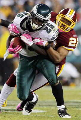 PHILADELPHIA - OCTOBER 03:  LeSean McCoy #25 of the Philadelphia Eagles is tackled by Carlos Rogers #22 of the Washington Redskins on October 3, 2010 at Lincoln Financial Field in Philadelphia, Pennsylvania. The Redskins defeated the Eagles 17-12.  (Photo