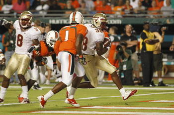 MIAMI, FL - OCTOBER 9: Jermaine Thomas #38 of the Florida State Seminoles eludes the tackle of Brandon Harris #1 of the Miami Hurricanes to score a touchdown on October 9, 2010 at Sun Life Stadium in Miami, Florida. (Photo by Joel Auerbach/Getty Images)