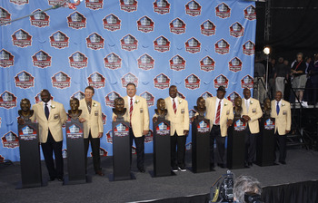 CANTON, OH - AUGUST 7: The Class of 2010 (from left, Emmitt Smith, Dick LeBeau, Russ Grimm, John Randle, Rickey Jackson, Jerry Rice and Floyd Little) pose with their busts following the Pro Football Hall of Fame Enshrinement Ceremony at the Pro Football H