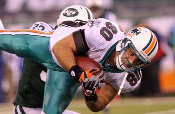 EAST RUTHERFORD, NJ - DECEMBER 12: Anthony Fasano #80 of the Miami Dolphins pulls in a pass against the New York Jets at New Meadowlands Stadium on December 12, 2010 in East Rutherford, New Jersey.  (Photo by Nick Laham/Getty Images)