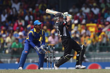 COLOMBO, SRI LANKA - MARCH 29:  Brendon McCullum (R) of New Zealand hits to the legside as wicketkeeper Kumar Sangakkara (L) looks on during the 2011 ICC World Cup Semi-Final match between New Zealand and Sri Lanka at the R. Premadasa Stadium on March 29,