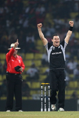 KANDY, SRI LANKA - MARCH 08:  Nathan McCullum of New Zealand celebrates taking the wicket of Abdur Rehman during the New Zealand v Pakistan 2011 ICC World Cup Group A match at the Pallekele Cricket Stadium on March 8, 2011 in Kandy, Sri Lanka.  (Photo by