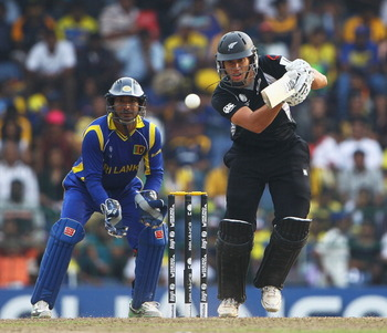 COLOMBO, SRI LANKA - MARCH 29:  Ross Taylor of New Zealand hits the ball towards the boundary, as Kumar Sangakkara of Sri Lanka looks on during the 2011 ICC World Cup Semi-Final match between New Zealand and Sri Lanka at R. Premadasa Stadium on March 29,