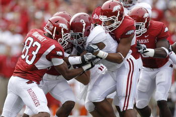 FAYETTEVILLE - SEPTEMBER 25: Trent Richardson #3 of the Alabama Crimson Tide gets tackled by a group of Arkansas Razorbacks defenders during the first half at Donald W. Reynolds Razorback Stadium on September 25, 2010 in Fayetteville, Arkansas. (Photo by