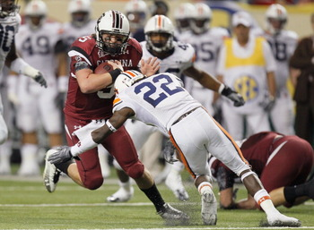 ATLANTA, GA - DECEMBER 04:  Stephen Garcia #5 of the South Carolina Gamecocks is tackled by T'Sharvan Bell #22 of the Auburn Tigers during the 2010 SEC Championship at Georgia Dome on December 4, 2010 in Atlanta, Georgia.  (Photo by Kevin C. Cox/Getty Ima