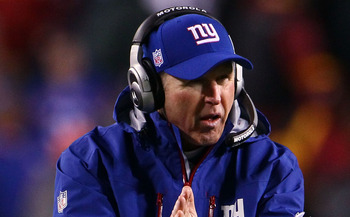 LANDOVER, MD - JANUARY 02:  Head coach Tom Coughlin of the New York Giants encourages his players in the fourth quarter against the Washington Redskins at FedEx Field on January 2, 2011 in Landover, Maryland. The Giants won the game 17-14.  (Photo by Win