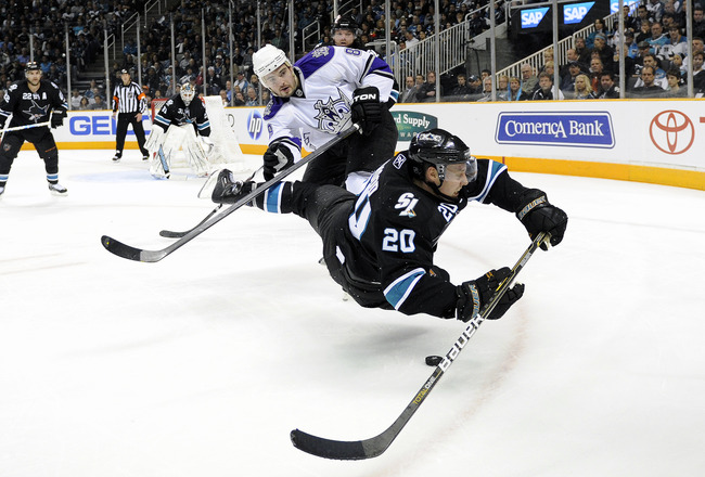SAN JOSE, CA - APRIL 14: Drew Doughty #8 of the Los Angeles Kings gets a penalty call for tripping Kyle Wellwood #20 of the San Jose Sharks in Game One of the Western Conference Quarterfinals  during the 2011 NHL Stanley Cup Playoffs at the HP Pavilion on