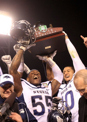 SAN FRANCISCO, CA - JANUARY 09:  Dontay Moch #55 and Colin Kaepernick #10 of the Nevada Wolf Pack hold up the trophy after they beat Boston College in the Kraft Fight Hunger Bowl at AT&T Park on January 9, 2011 in San Francisco, California.  (Photo by Ezr