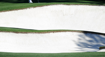 AUGUSTA, GA - APRIL 06:  Adam Scott of Australia waits near a bunker during a practice round prior to the 2011 Masters Tournament at Augusta National Golf Club on April 6, 2011 in Augusta, Georgia.  (Photo by Harry How/Getty Images)