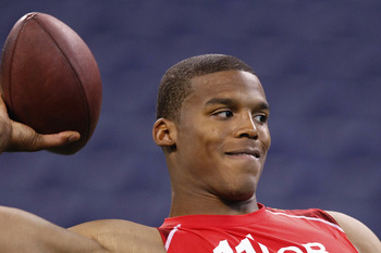 INDIANAPOLIS, IN - FEBRUARY 27: Cam Newton passes the ball during the 2011 NFL Scouting Combine at Lucas Oil Stadium on February 27, 2011 in Indianapolis, Indiana. (Photo by Joe Robbins/Getty Images)