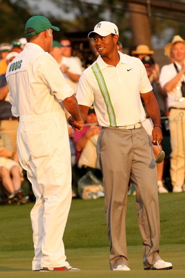 AUGUSTA, GA - APRIL 08:  Tiger Woods (R) shakes hands with his caddie Steve Williams on the 18th green after his six-under par 66 during the second round of the 2011 Masters Tournament at Augusta National Golf Club on April 8, 2011 in Augusta, Georgia.  (