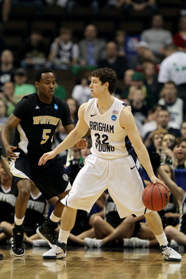 DENVER, CO - MARCH 17:  Jimmer Fredette #32 of the Brigham Young Cougars handles the ball against Jamar Diggs #5 of the Wofford Terriers during the second round of the 2011 NCAA men's basketball tournament at Pepsi Center on March 17, 2011 in Denver, Colo