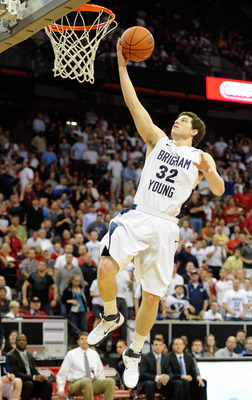 LAS VEGAS, NV - MARCH 11:  Jimmer Fredette #32 of the Brigham Young University Cougars scores a layup against the New Mexico Lobos during a semifinal game of the Conoco Mountain West Conference Basketball tournament at the Thomas & Mack Center March 11, 2
