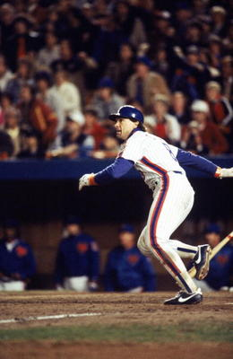 FLUSHING, NY - OCTOBER 27:  Gary Carter #8 of the New York Mets runs to first base during Game seven of the 1986 World Series against the Boston Red Sox at Shea Stadium on October 27, 1986 in Flushing, New York. The Mets defeated the Red Sox 8-5 to win th