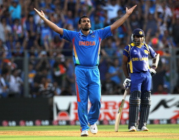 MUMBAI, INDIA - APRIL 02:  Zaheer Khan of India celebrates after taking the wicket of Chamara Kapugedera of Sri Lanka with Mahela Jayawardene of Sri Lanka looking on during the 2011 ICC World Cup Final between India and Sri Lanka at Wankhede Stadium on Ap