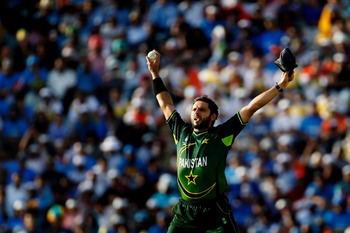 MOHALI, INDIA - MARCH 30: Captain Shahid Afridi of Pakistan celebrates after taking the catch to dismiss Sachin Tendulkar of India off the bowling of Saeed Ajmal of Pakistan during the 2011 ICC World Cup second Semi-Final between India and Pakistan at Pun