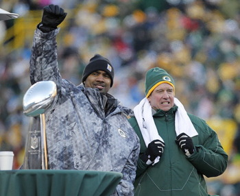 GREEN BAY, WI - FEBRUARY 08:  Green Bay Packers cornerback Charles Woodson and Defensive Coordinator Dom Capers take the stage to address the fans during the Packers victory celebration at Lambeau Field on February 8, 2011 in Green Bay, Wisconsin.  (Photo