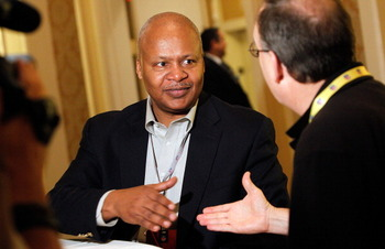 No thats not Jake Locker's agent shaking Jim Caldwell's hand.