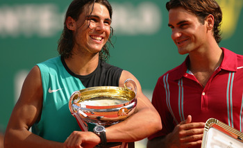 MONTE CARLO, MONACO - APRIL 22:  Rafael Nadal of Spain (L) laughs with Roger Federer of Switzerland on the podium after Nadal's victory by 6-4,6-4 during the Final on Day Six of the Masters Series at the Monte Carlo Country Club, April 22, 2007 in Monte C