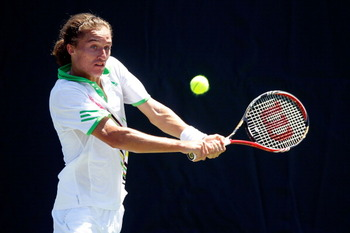 KEY BISCAYNE, FL - MARCH 26:  Alexandr Dolgopolov of the Ukraine returns against Andreas Seppi of Italy during the Sony Ericsson Open at Crandon Park Tennis Center on March 26, 2011 in Key Biscayne, Florida.  (Photo by Matthew Stockman/Getty Images)