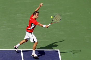 INDIAN WELLS, CA - MARCH 14: Philipp Kohlschreiber of Germany returns a shot to Robin Soderling of Sweden during the BNP Paribas Open at the Indian Wells Tennis Garden on March 14, 2011 in Indian Wells, California.  (Photo by Matthew Stockman/Getty Images