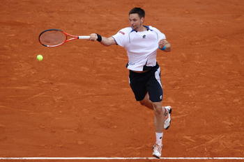 PARIS - JUNE 06:  Robin Soderling of Sweden plays a forehand during the men's singles final match between Robin Soderling of Sweden and Rafael Nadal of Spain on day fifteen of the French Open at Roland Garros on June 6, 2010 in Paris, France.  (Photo by C